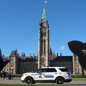 Photograph of RCMP vehicle stopped infront of the Canadian Parliament buildings in Ottawa