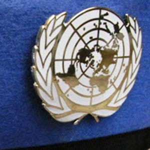 Photograph of a United Nations cap badge