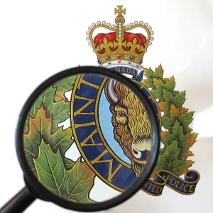 Photograph of a magnify glass over the RCMP crest